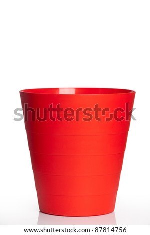 Big red plastic basket isolated over white background