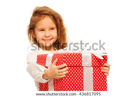 Big red present held by cute little girl