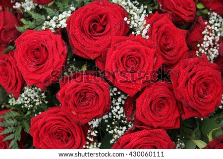 Big red roses in a wedding arrangement - stock photo