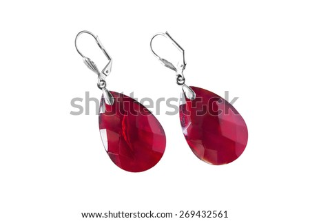 Big red ruby earrings on white background - stock photo