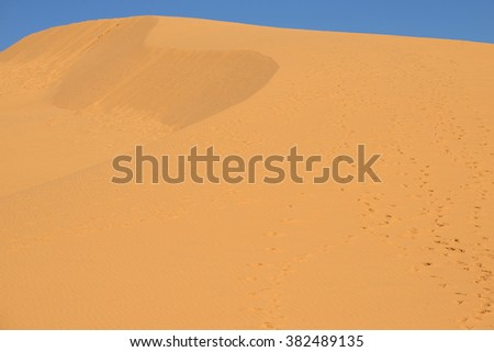 Big red sand dune close up. The surroundings of the village of Mui Ne, Vietnam - stock photo