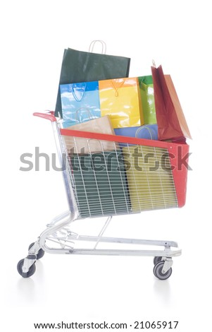 Big red shopping cart full of shopping bags - stock photo