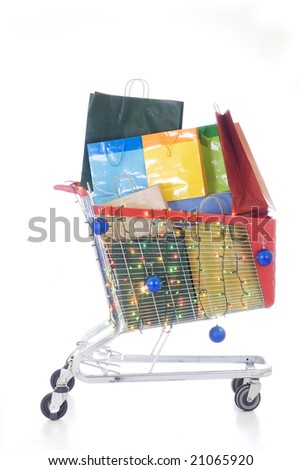 Big red shopping cart full of shopping bags and christmas decorations - stock photo