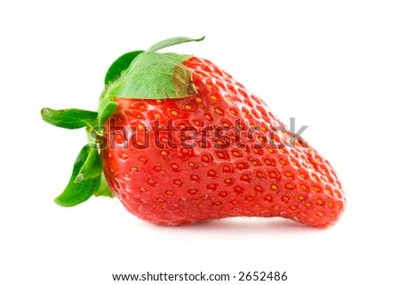 Big red strawberry against white background