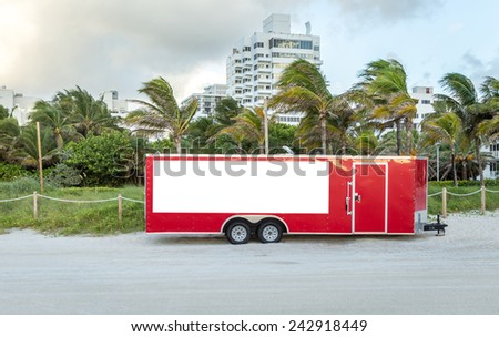 Big red trailer standing on the beach in Miami USA - stock photo