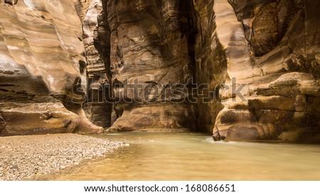 Big river canyon Wadi Mujib, located close to Dead Sea, Jordan - stock photo
