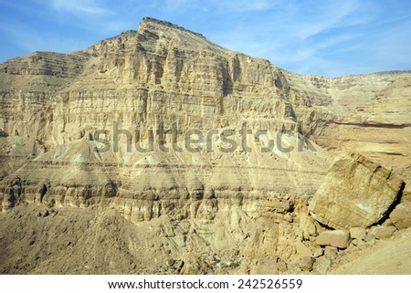 Big rock in Makhtesh Katan crater in Negev desert in Israel                                - stock photo