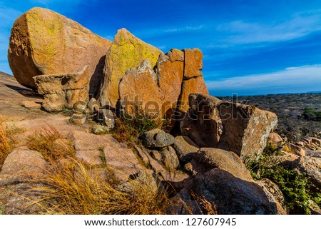 Big Rocks.  Amazingly Large Granite Boulders with Yellow Lichen of the Legendary Enchanted Rock, a Small Dome Mountain, in the Texas Hill Country. - stock photo