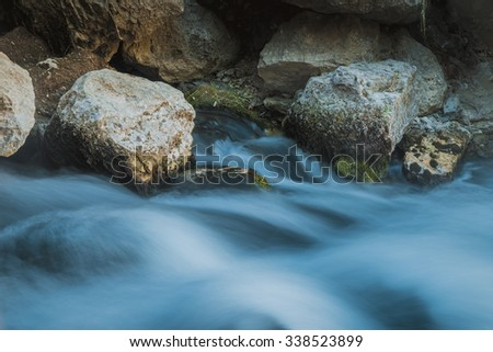 Big rocks inside water fall in Iraqi city of Erbil - stock photo