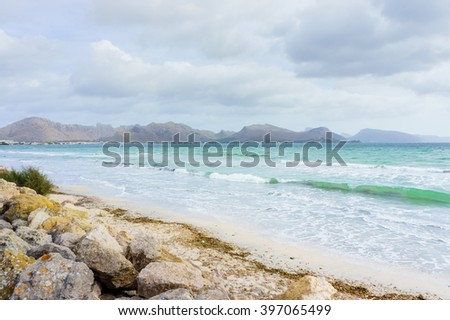 Big rocks near sea. Wavy sea near rocky beach. Transparent sea water. Storm on sea. Daylight sea. Sea water. Stormy sea day. Clouds above the sea. Sea waves at storm. Storm sea, Majorca. Sea view. - stock photo