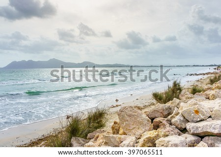 Big rocks on a seashore, Majorca. Wavy sea near rocky beach. Storm on sea. Daylight sea. Sea water. Stormy sea day. Stormy clouds above the sea. Sea waves at storm. Storm waves, Majorca. Big sea rocks - stock photo