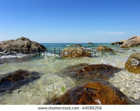 big rocks on Long Island Sound beach - stock photo