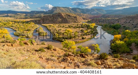Big rocky mountain valley with creek and cloudy blue sky, Grand Canyon, USA - stock photo