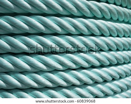 Big roll of green nylon cable rope - stock photo