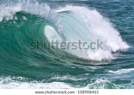 Big roller ocean wave with white foam. Close-up image - stock photo