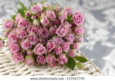 Big roses on Basket and Silk - stock photo