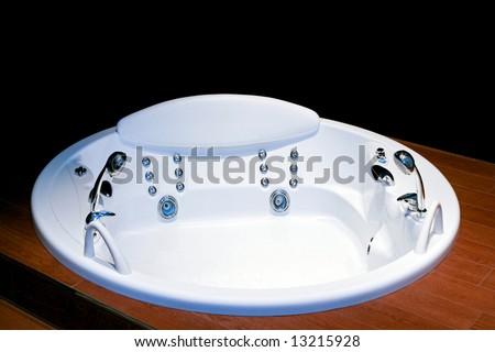 Big round bathtub spa with hydro massage - stock photo