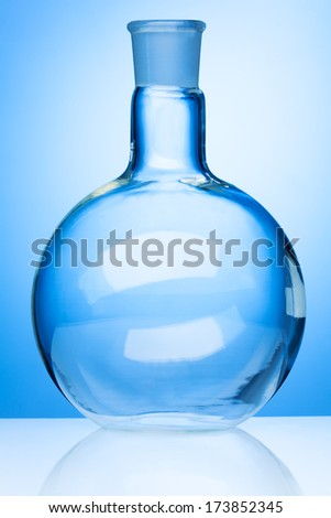 Big round glass flask in laboratory light - stock photo