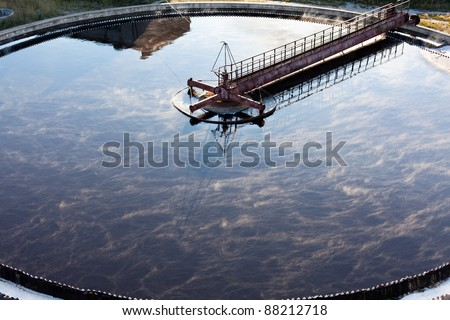 Big round sedimentation drainage. Water settling, purification in the tank by biological organisms on water station. Close up - stock photo