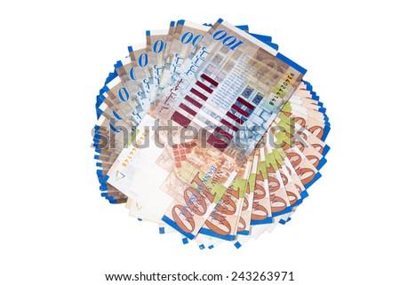 Big round stack of new israeli sheqel isolated on white background - stock photo