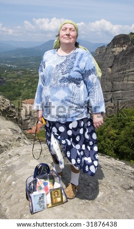 Big Russian woman - pilgrim in an orthodox mountain monastery Meteora, Greece
