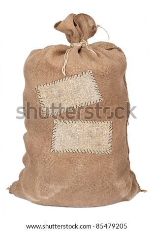 Big sack with labels - stock photo