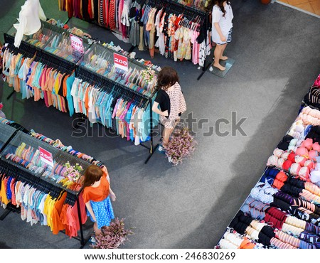 Big sale of fashionable women's clothing and lingerie in store. - stock photo