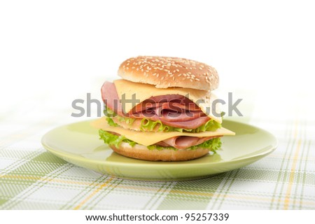 Big sandwich on a plate - stock photo