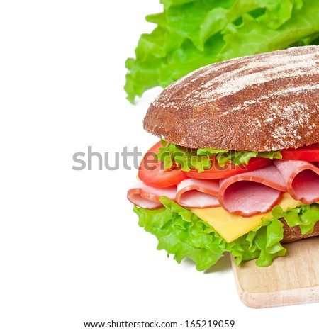 Big sandwich with ham and cheese - stock photo