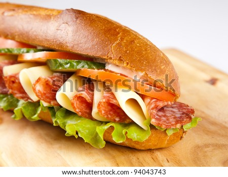 big sandwich with on wooden board
