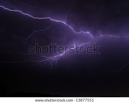Big scary lightning storm on a stormy night with house rooftops