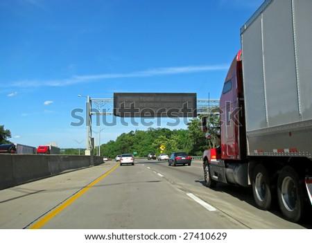 big semi trailer truck driving on highway - stock photo