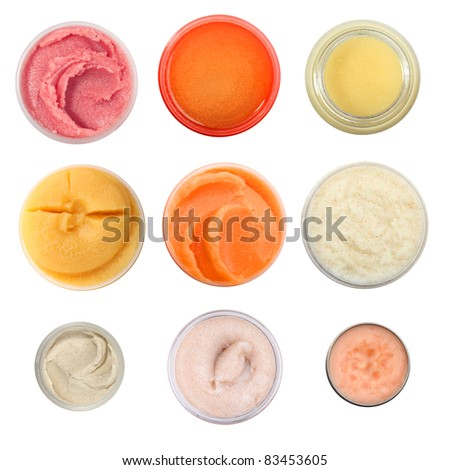 Big set of face and body cosmetic scrub, top view - stock photo