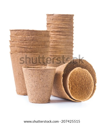 big set of peat pots isolated on white background - stock photo