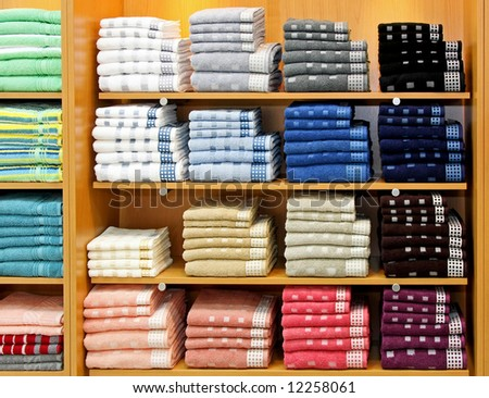 Big shelf with bunch of cool towels - stock photo