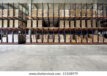 Big shelf with lot of pallets in warehouse - stock photo