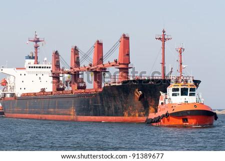 Big ship and tugboat. Gdansk, Poland. - stock photo