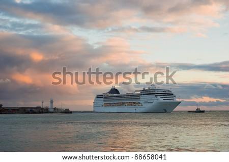 Big ship evening sailing off from Yalta port, Crimea, Ukraine. - stock photo
