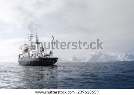 Big ship in Antarctic waters - stock photo