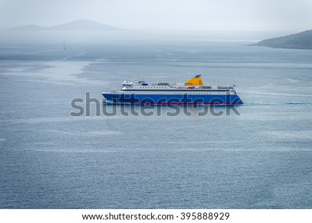 Big ship sailing the aegean sea during summer in Greece. - stock photo