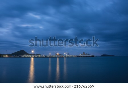 Big ship yard and sea under cloudy sky in twilight time