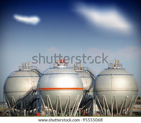Big silver gaz and fuel Storage Tanks - stock photo