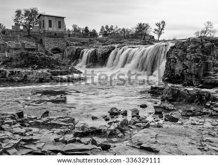 Big Sioux River running through Falls Park in Sioux Falls, South Dakota - stock photo