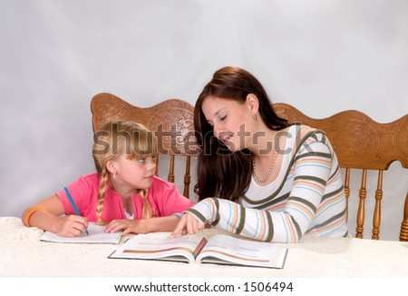 Big sister helping with homework - stock photo