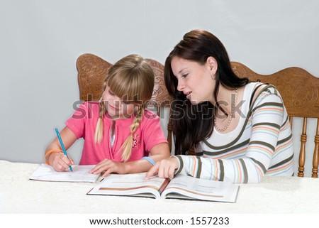 Big sister helping with homework - stock photo
