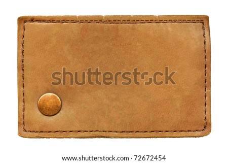 Big size blank grungy artificial leather jeans label with bronze metal rivet, highly detailed, isolated on white background - stock photo