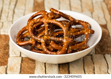 Big sized salted pretzels in a bowl. - stock photo