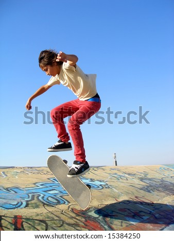 Big skate park showing a boy skating - stock photo