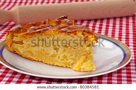 Big slice of apple pie, with rolling pin