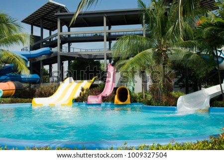 Big Slide Water And In Pool At Outdoor For People Playing Swimming Park